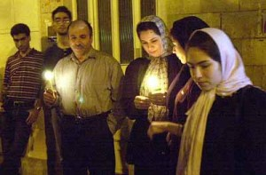 Iranian people light candles in Madar (Mother) Square in Tehran on Sept. 18 in memory of victims of the recent terrorist attacks in the United States. AP PHOTO/HASAN SARBAKHSHIN September 19, 2001